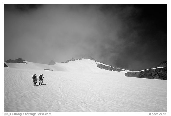 Mountaineers climbing a snow field on Sahale Peak,  North Cascades National Park.  (black and white)