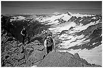 Mountaineers on ridge below  summit of Sahale Peak, North Cascades National Park. Washington, USA. (black and white)