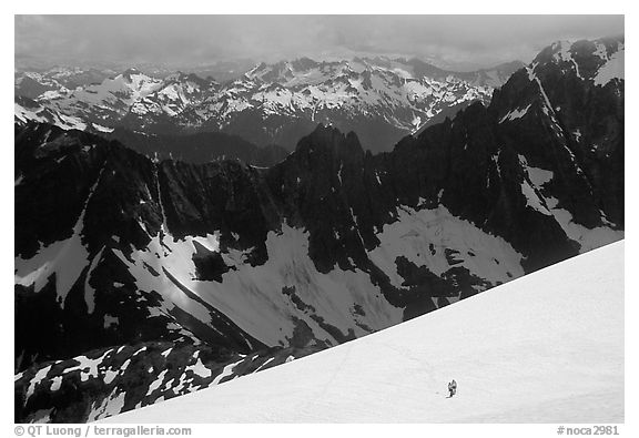 Mountain ridges, and mountaineers on snow field, North Cascades National Park.  (black and white)