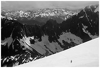 Mountain ridges, and mountaineers on snow field, North Cascades National Park. Washington, USA. (black and white)