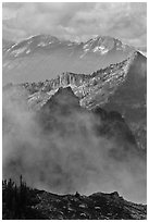 Peaks partly obscured by clouds, North Cascades National Park.  ( black and white)