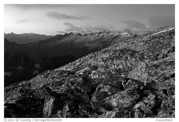 Rocky slope and distant range at dusk, North Cascades National Park.  (black and white)