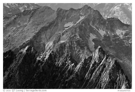 Steep forested spires in dabbled light, North Cascades National Park.  (black and white)