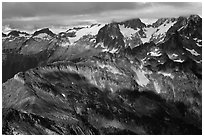 Cloud-capped mountains in dabbled light, North Cascades National Park.  ( black and white)