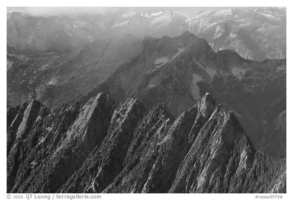 Steep forested spires in foggy light, North Cascades National Park.  (black and white)
