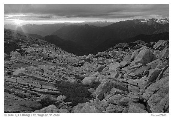 Last rays of sunset color rocks in alpine basin, North Cascades National Park.  (black and white)