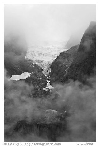 Hanging glacier in fog, North Cascades National Park.  (black and white)