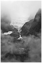 Hanging glacier in fog, North Cascades National Park. Washington, USA. (black and white)