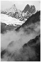 Inspiration Peak and the Pyramid rising above clouds, North Cascades National Park. Washington, USA. (black and white)