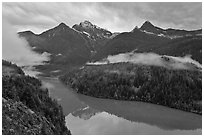 Colonial Peak and Pyramid Peak above Diablo Lake on rainy evening, North Cascades National Park Service Complex. Washington, USA. (black and white)