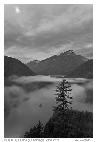 Diablo Lake, fog, and moon, dawn, North Cascades National Park Service Complex.  (black and white)