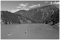 Canoes and kayaks on Diablo Lake,  North Cascades National Park Service Complex. Washington, USA. (black and white)