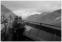 Couple at bow of boat looking at rainbow over Lake Chelan, North Cascades National Park Service Complex.  ( black and white)