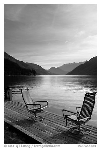 Two chairs on the shore of Lake Chelan, Stehekin, North Cascades National Park Service Complex.  (black and white)