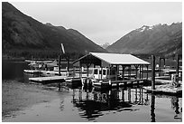 Fuel pump, boat, and floatplane, Stehekin, North Cascades National Park Service Complex.  ( black and white)