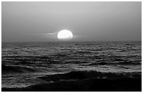 Disc of sun setting in  pacific, Shi-shi beach. Olympic National Park, Washington, USA. (black and white)