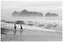 Children running along surf, Rialto Beach. Olympic National Park, Washington, USA. (black and white)