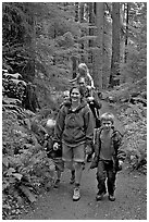 Family walking on forest trail. Olympic National Park, Washington, USA. (black and white)