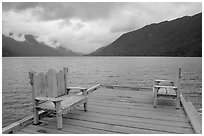 Two chairs on pier, Crescent Lake. Olympic National Park, Washington, USA. (black and white)