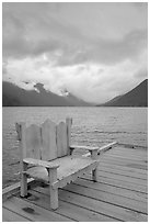 Chair on pier, Crescent Lake. Olympic National Park, Washington, USA. (black and white)