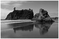 Sea stacks reflected on wet beach, Ruby Beach. Olympic National Park, Washington, USA. (black and white)