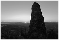 Rock pillar and setting sun. Pinnacles National Park, California, USA. (black and white)