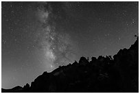 Rocky ridge and star-filled sky with Milky Way. Pinnacles National Park, California, USA. (black and white)
