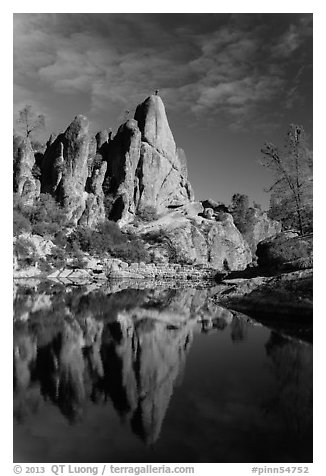 Climber standing on spire next to Bear Gulch Reservoir. Pinnacles National Park (black and white)