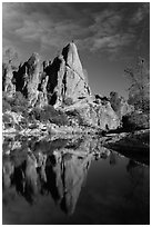 Climber standing on spire next to Bear Gulch Reservoir. Pinnacles National Park, California, USA. (black and white)