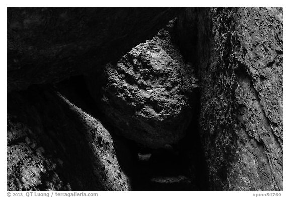 Dark passage with wedged boulder, Balconies Cave. Pinnacles National Park (black and white)