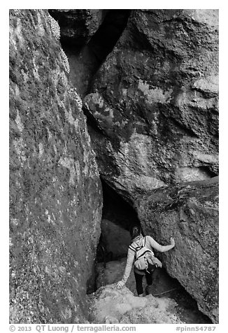 Woman walking into Balconies Cave. Pinnacles National Park (black and white)