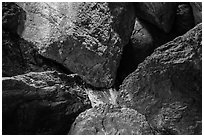 Jumble of rocks in talus cave. Pinnacles National Park, California, USA. (black and white)