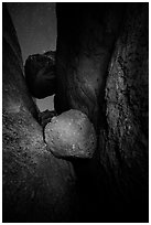 Boulders wedged in Balconies Cave at night. Pinnacles National Park, California, USA. (black and white)