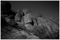 Looking up rock towers and starry night sky. Pinnacles National Park ( black and white)
