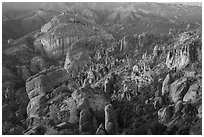 Innumerable rock spires and cliffs seen at sunset. Pinnacles National Park ( black and white)
