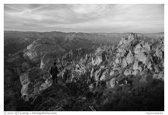 Visitor looking, Balconies and Square Block at sunset. Pinnacles National Park (black and white)