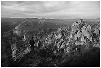 Visitor looking, Balconies and Square Block at sunset. Pinnacles National Park ( black and white)