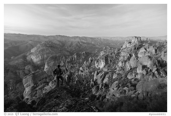 Visitor looking, Balconies and Square Block at dusk. Pinnacles National Park (black and white)