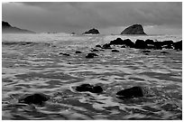 Turbulent waters, stormy dusk, False Klamath Cove. Redwood National Park, California, USA. (black and white)