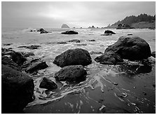 Sand, boulders and surf, Hidden Beach. Redwood National Park, California, USA. (black and white)