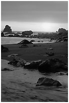 Stream on beach at sunset, False Klamath cove. Redwood National Park, California, USA. (black and white)