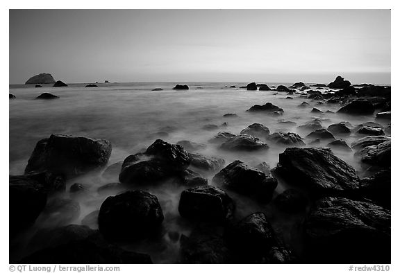 Boulders and ocean at dusk, False Klamath cove. Redwood National Park (black and white)