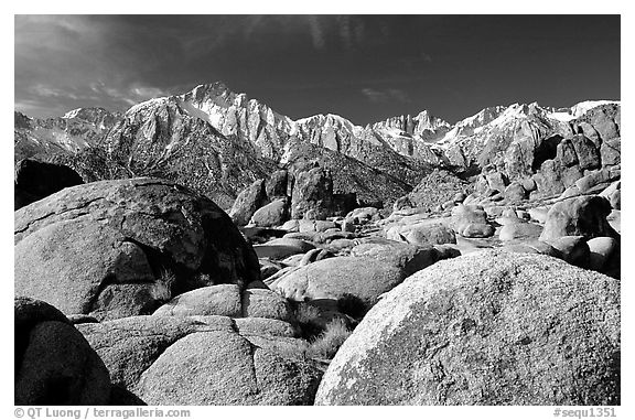 Volcanic boulders in Alabama hills and Sierras, morning. Sequoia National Park (black and white)