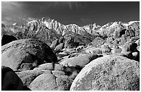 Volcanic boulders in Alabama hills and Sierras, morning. Sequoia National Park, California, USA. (black and white)