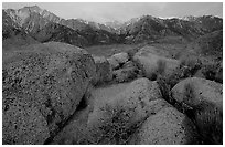 Volcanic boulders in Alabama hills and Sierras, sunrise. Sequoia National Park, California, USA. (black and white)