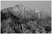 Volcanic boulders in Alabama hills and Lone Pine Peak, dawn. Sequoia National Park, California, USA. (black and white)