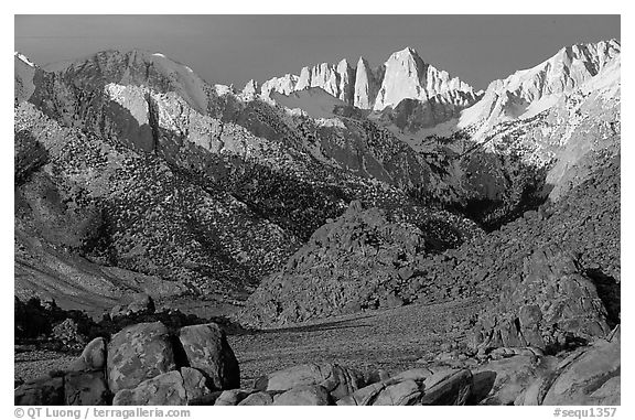 Volcanic boulders in Alabama hills and Mt Whitney, sunrise. Sequoia National Park (black and white)