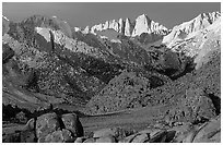 Volcanic boulders in Alabama hills and Mt Whitney, sunrise. Sequoia National Park, California, USA. (black and white)