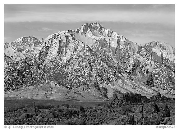 Volcanic boulders in Alabama hills and Lone Pine Peak, sunrise. Sequoia National Park (black and white)