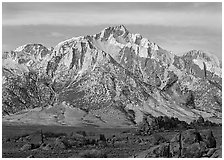 Volcanic boulders in Alabama hills and Lone Pine Peak, sunrise. Sequoia National Park ( black and white)